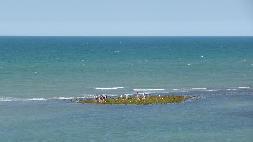 Explorers On Sheringham Beach At Low Tide
